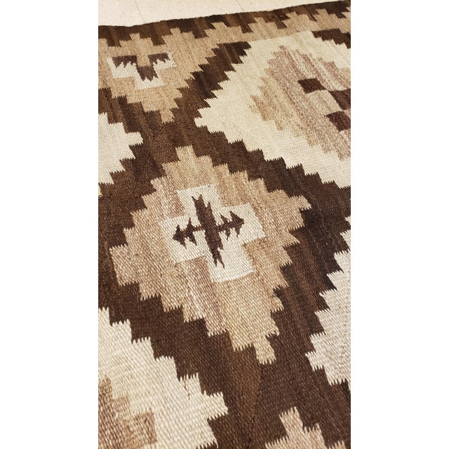 Brown Early 20th Century Antique Navajo Handmade Wool Rug- 5′ × 6′4″ For Sale - Image 8 of 9