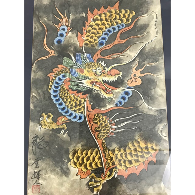 Dramatic Japanese watercolor of an impressive dragon flying amongst the gray storm clouds. Dragons are one of the twelve...