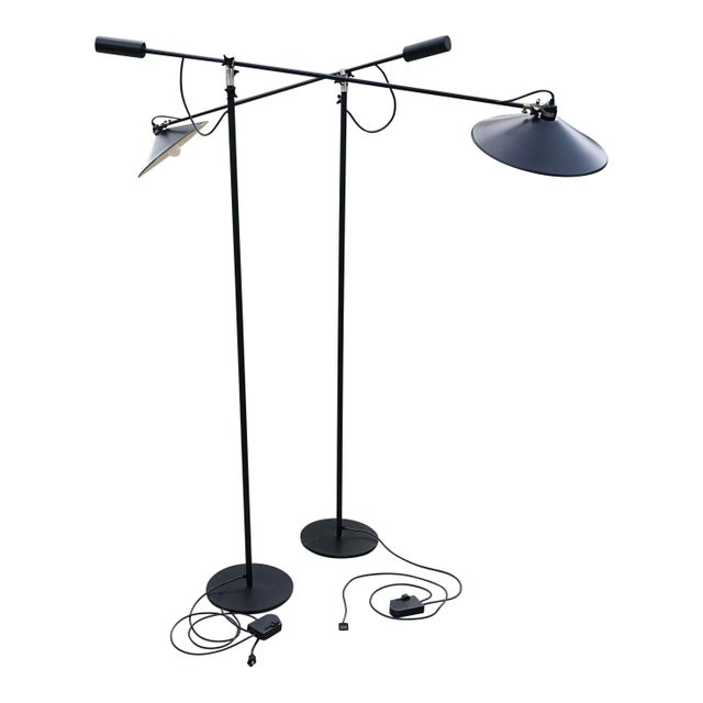 Pair of black cantilever adjustable floor lamps. Made by Relco, probably in the 60's. Gilt clamps stamped VICTOR, the...