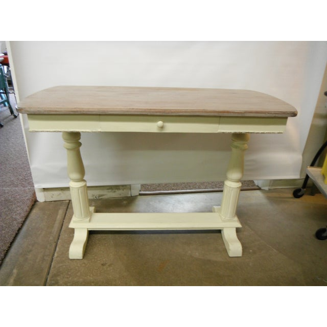 Beautiful vintage writing desk updated in a pale, pale yellow, the surface has a light white wash affect to still show the...