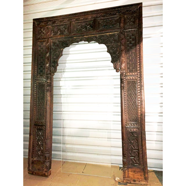 Arch carved antique welcome gate teak architectural Indian doorway boho chic, used for a past LCDQ La Cienega Design...