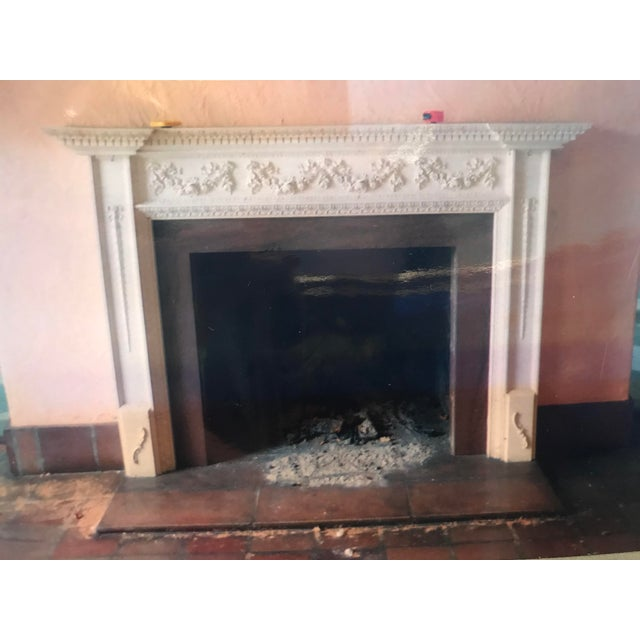 "English ""Georgian ""style mantel circa 1920s, painted white with carved garlands, swags and bellflower motif in Robert Adam..."