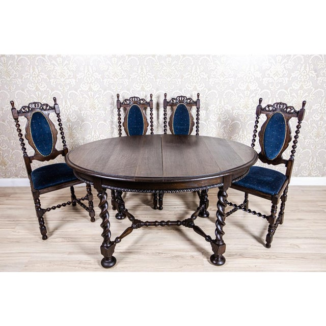 We present you this oak furniture set that includes a big, oval extendable table and four chairs with upholstered...