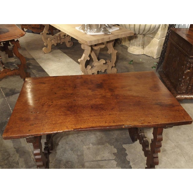 From Italy, this rich, hand carved writing table dates to the 18th century. The top is one single plank of walnut wood,...