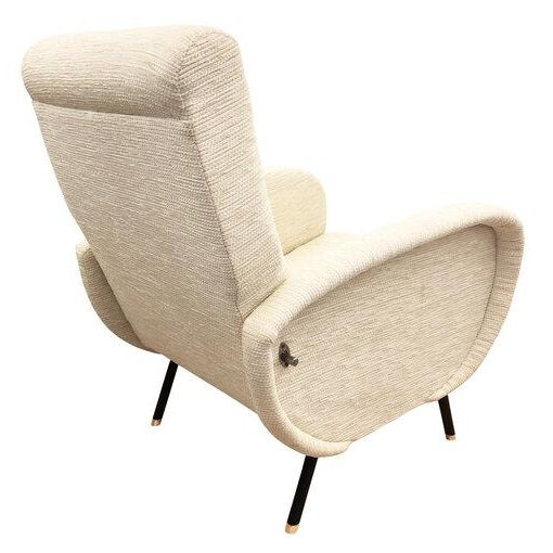 Mid-Century reclining lounge chair in the manner of Marco Zanuso. Upholstered in an off-white fabric and with black...