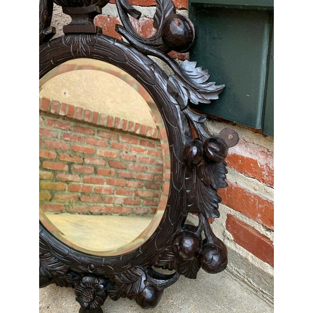 19th Century Antique English Black Forest Style Carved Dark Oak Oval Wall Mirror For Sale In Dallas - Image 6 of 13