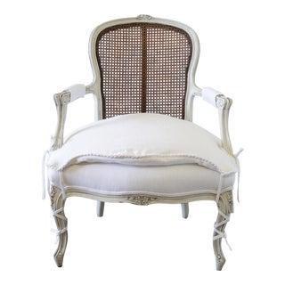 20th Century French Cane Back Open Arm Chair With Linen Slip Cover For Sale