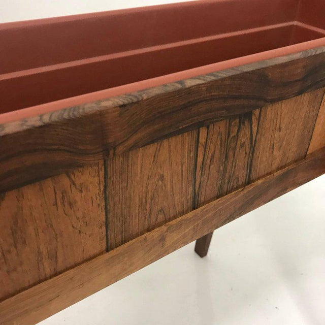 For your consideration, a Mid-Century Modern Brazilian rosewood planter. Made in Denmark, circa the 1960s.