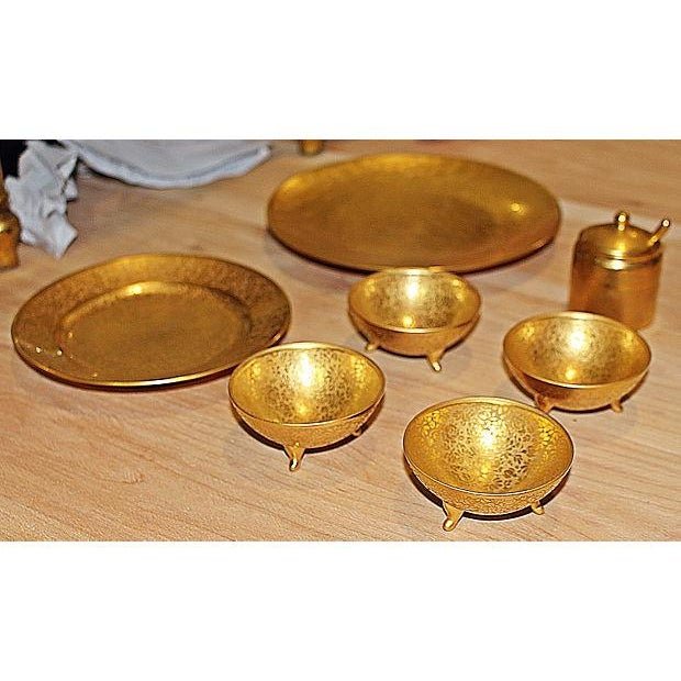 "An assembled set of seven serving pieces in 23k all-over-gold decoration by Picard. Sugar meas:2.75""Dia x 2.75""H; large..."