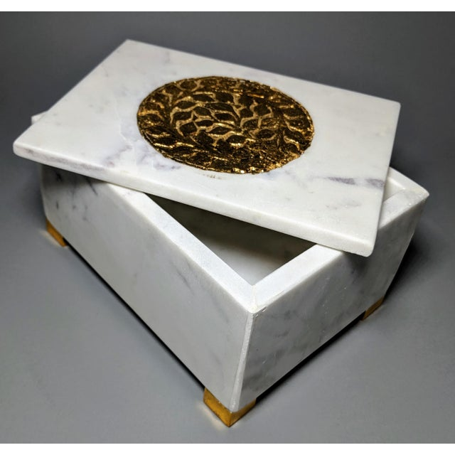 This heavyweight white marble and brass colored metal accented box is classy but understated at the same time....