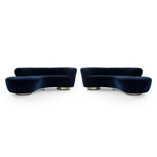 Rare set of curved opposing sofas designed by the late Vladimir Kagan for Directional, circa 1970s. Featuring fully...