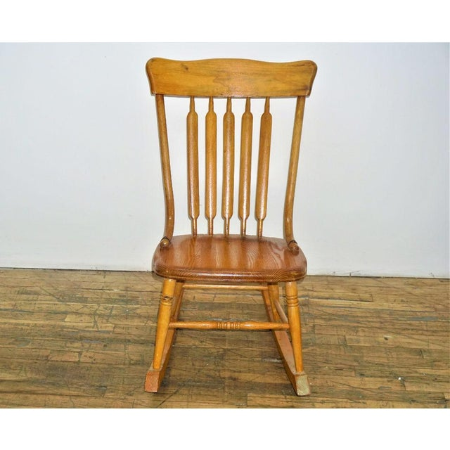 Made out of natural maple by Russsel Wright for the Conant Ball Furniture Company, this vintage rocking chair can...