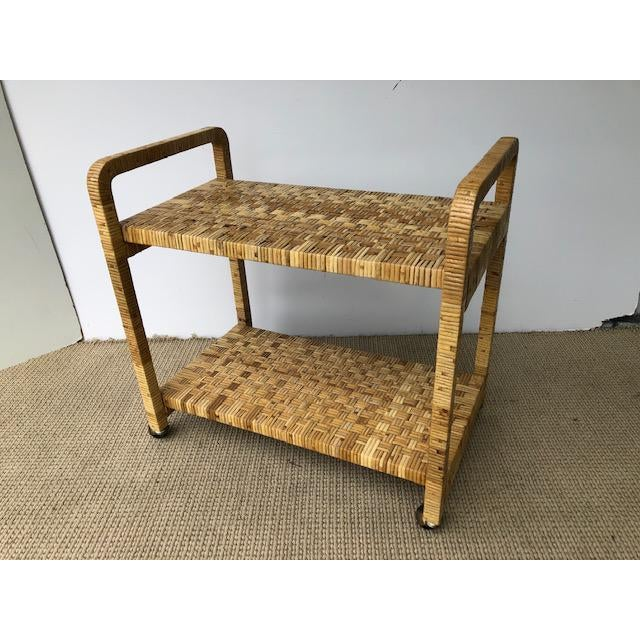 Great boho chic woven rattan bar cart. Great condition made in the 1980s.