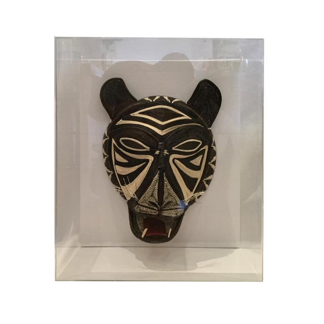 This handmade woven shaman mask in lucite box frame is a truly amazing work of art. Will truly stand out in any room and...