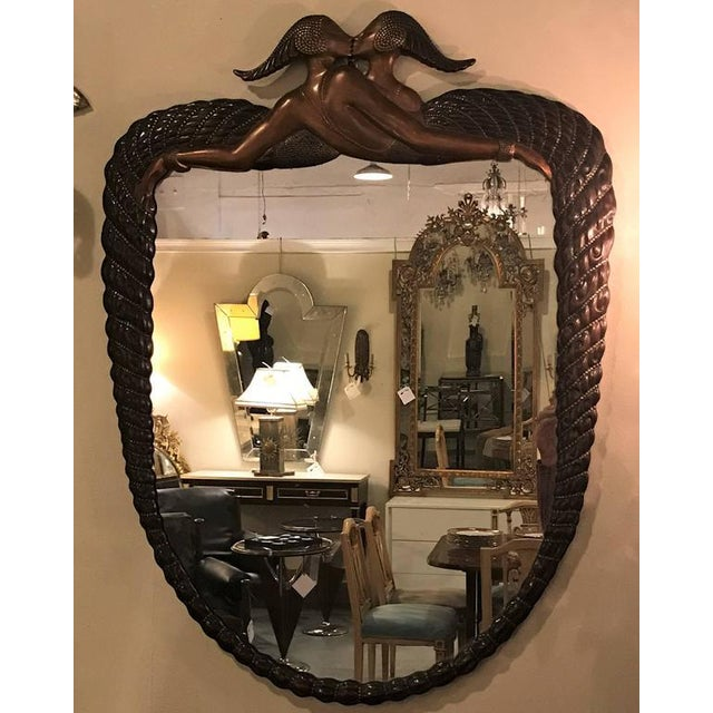 Signed ErTe mirror terminating in two kissing lovers both woman. Romain de Tirtoff was a Russian-born French artist and...