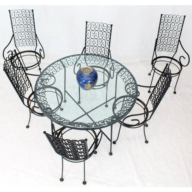 Mid-Century Modern wrought iron outdoor seven pieces six chairs dining set attributed to Salterini. Price included the...