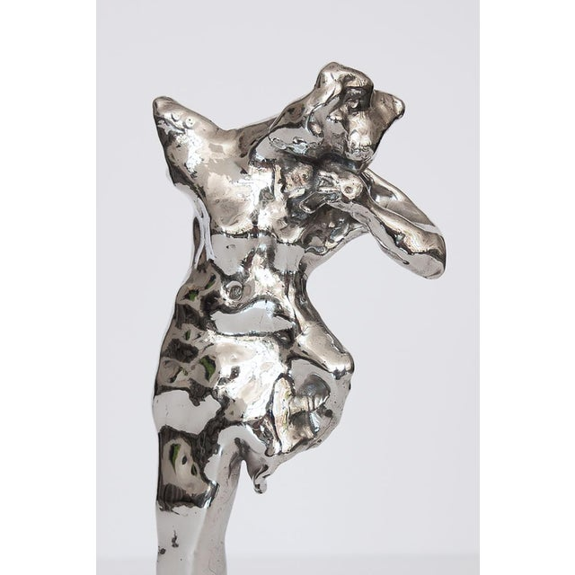 Abstract nude Modernist sculpture by Don Snyder, circa 1980. This sculpture features an polished nickel plated cast bronze...