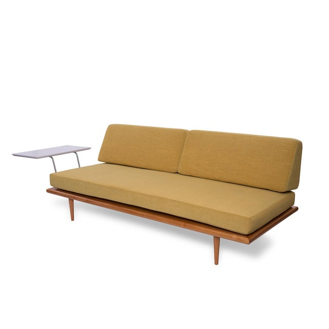 This early George Nelson for Herman Miller daybed with mustard yellow upholstery features a seldom-seen side table arm....