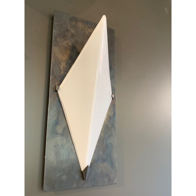 The Forma wall sconce with a bronze finish and white glass shade. wattage 60 c