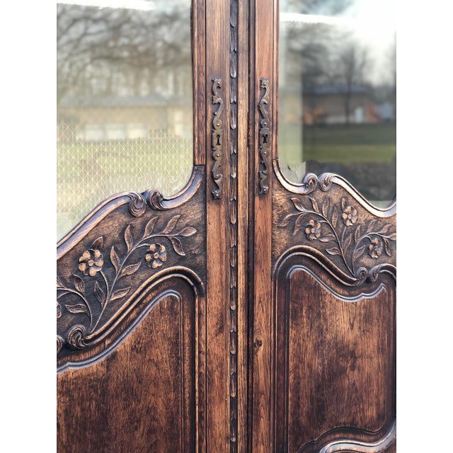 Beautifully carved and detailed 19th century antique Country French armoire / display cabinet. Two full length doors with...
