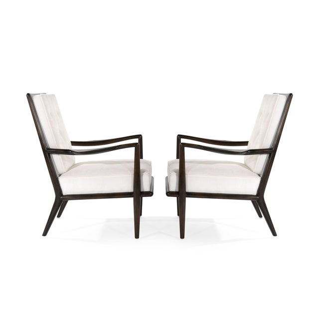 Extremely rare set of lounge chairs designed by T.H. Robsjohn-Gibbings for Widdicomb, circa 1950s. Walnut frames fully...