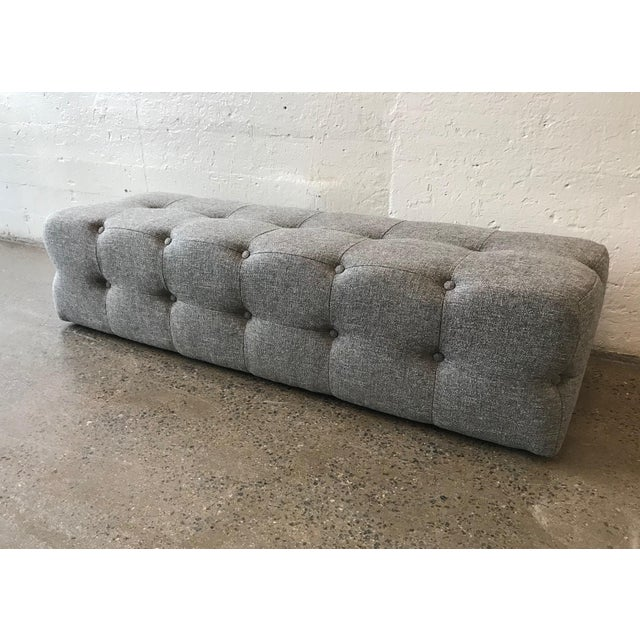Flavor custom design tufted bench. The bench is entirely tufted. The bench listed is in gray upholstery. COM is welcomed....