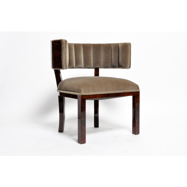 This luxurious klismos chair exudes modernist refinement. Burled walnut veneer is offset by new upholstery. The...