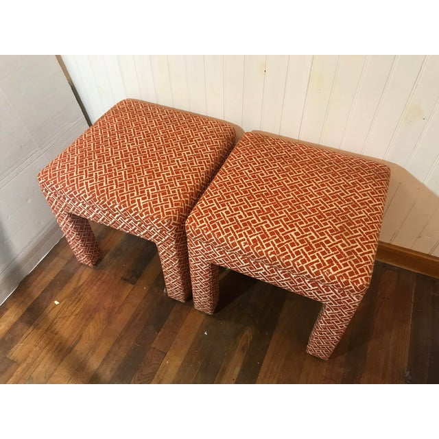 For sale is a vintage pair of fabric covered ottomans. Both included in the sale. Square shape. Orange and white graphic...