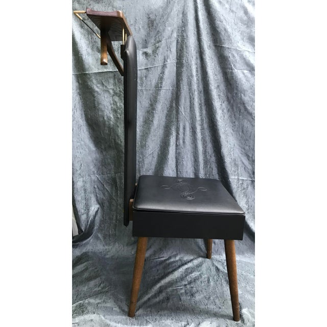 Vintage 1960s piece. Mid-century modern black vinyl butler chair with storage in seat.