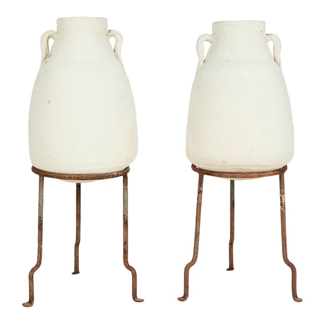 Pair of Vintage Mediterranean White Clay Vessels on Forged Iron Stands For Sale