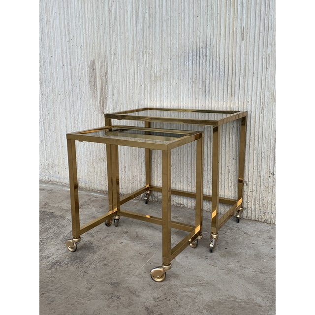 Mid-Century Modern Nesting Tables Italian Design 1970 in Brass With Smoked Glass and Wheels - a Pair For Sale - Image 3 of 11