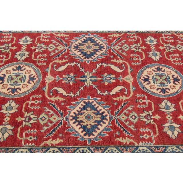Hand-knotted Kazak rug with an allover design. This piece has magnificent detailing and it would be perfect for your home....