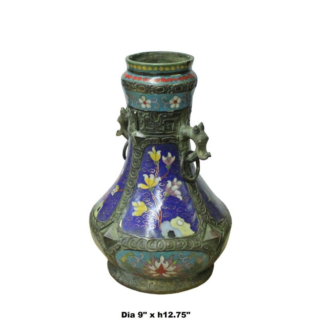 This is a traditional oriental Chinese decorative vase shape display made of metal and covered with blue multi-color...