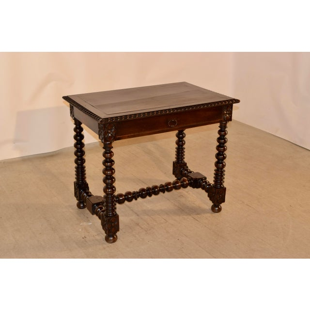 18th century French side table made from walnut. The top is made from a single plank, which has since has shrinkage...