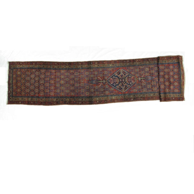 Wool pile hand made antique Persian Hamadan runner in excellent condition.