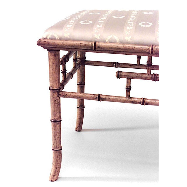 English Regency style (20th century) faux bamboo painted rectangular bench with upholstered seat.