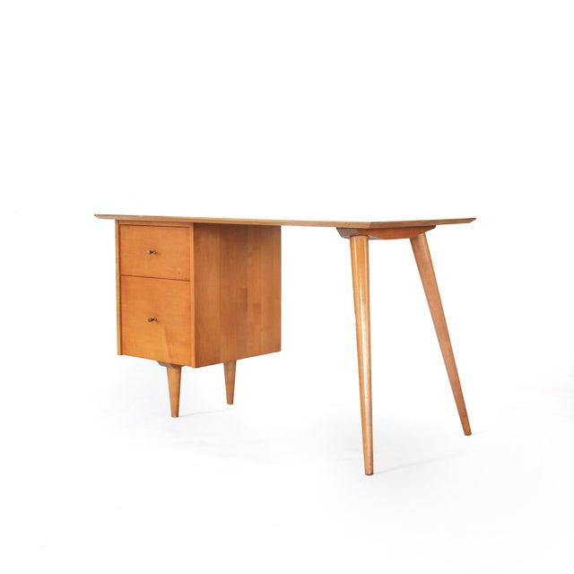 Presenting this lovely Paul McCobb Planner Group Desk by Winchendon Furniture in solid maple. Exceptional lines elevated...