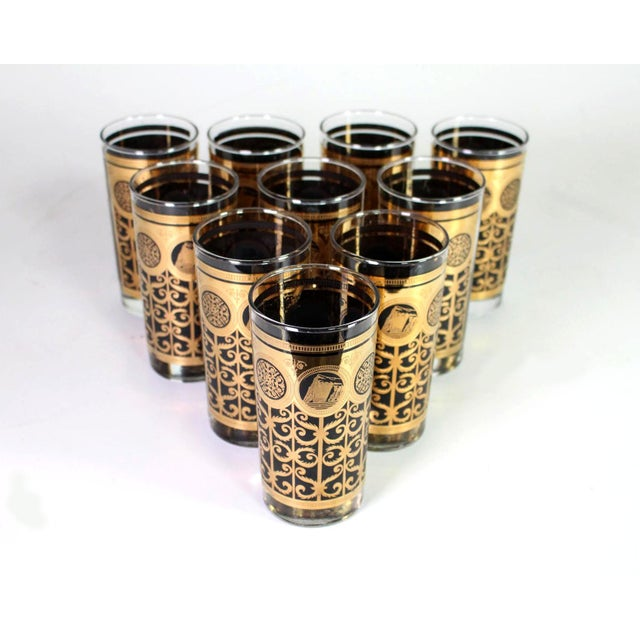 This gorgeous set of Hollywood Regency era 22k gold and black glasses designed by Fred Press are in near perfect condition...