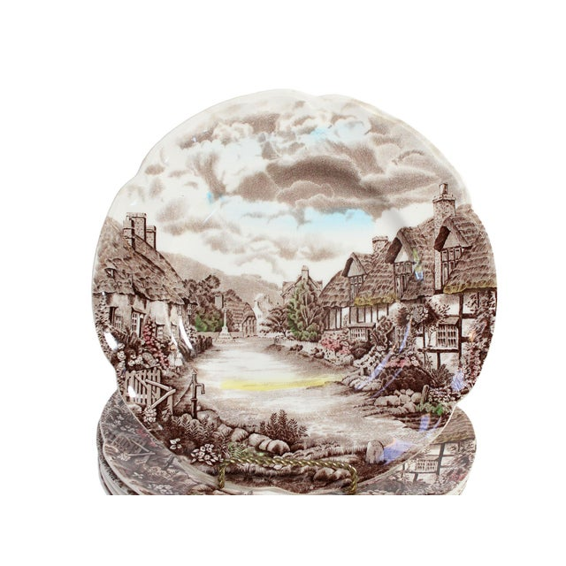 This beautiful warm set of 6 dinner plates by Johnson Bros show a scenic display of old English homes in the countryside...