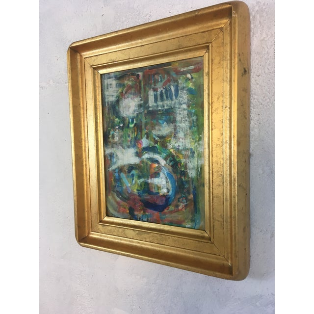 This oil on canvas is and is a great pop of color. The wide gold frame sets it off perfectly
