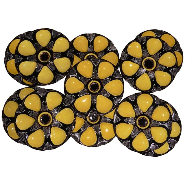 French faience black and yellow oyster plate signed Quimper, circa 1940. 11 plates available.