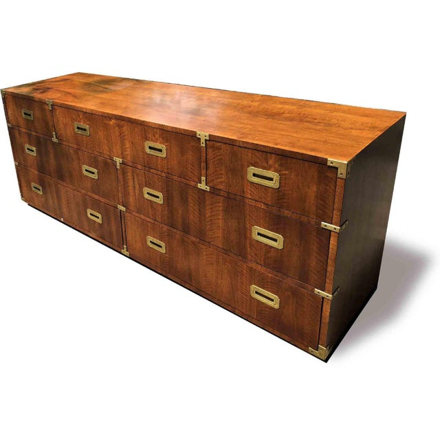 Iconic vintage Henredon campaign credenza or dresser. This 1970s dresser is complete with brass hardware and pulls and...