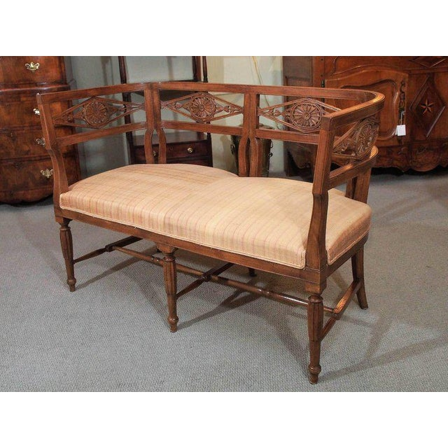 Antique French fruitwood settee. Directoire style, circa 1850.