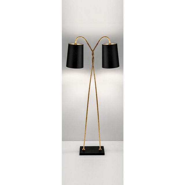 Florentine antique gold leaf on hand wrought iron tubing twisted with 2 arms supporting offset fabric shades. The...