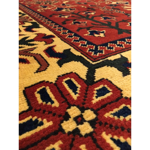 Bokhara rugs are stunningly designed and hand-knotted with - Symmetrical patterns of repeated oval and diamond shaped...