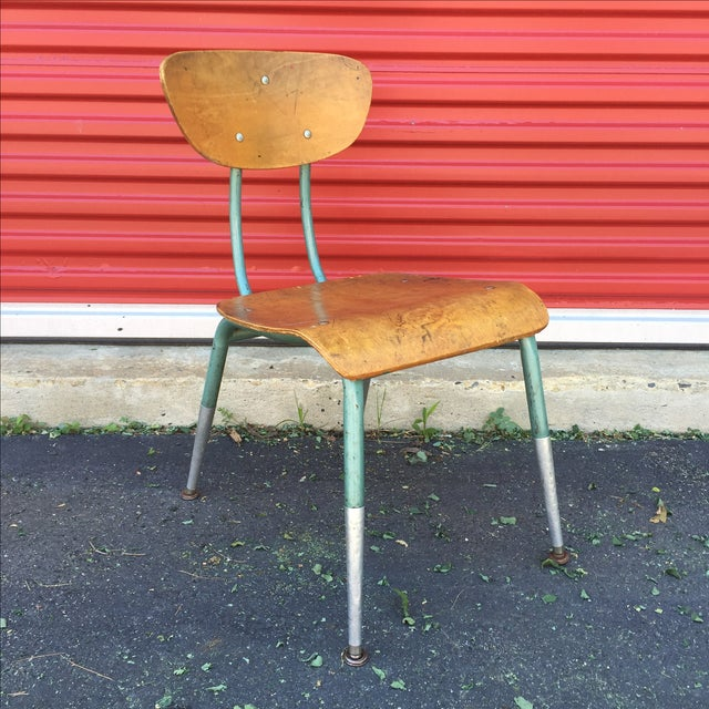 This mid century chair features a bentwood seat and back and green painted metal frame offering a modern flare and...