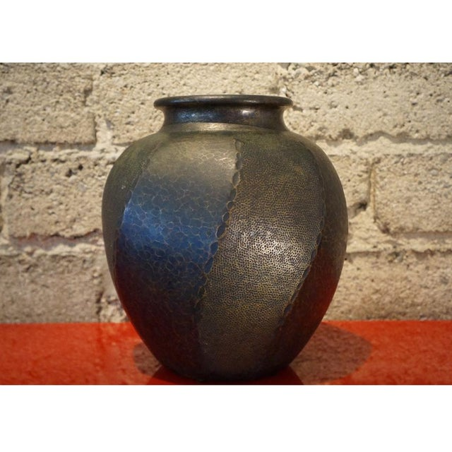 A beautiful hammered copper vase with a rich patina. The artist of this decorative vase was a Tsuba maker. The hand guard...