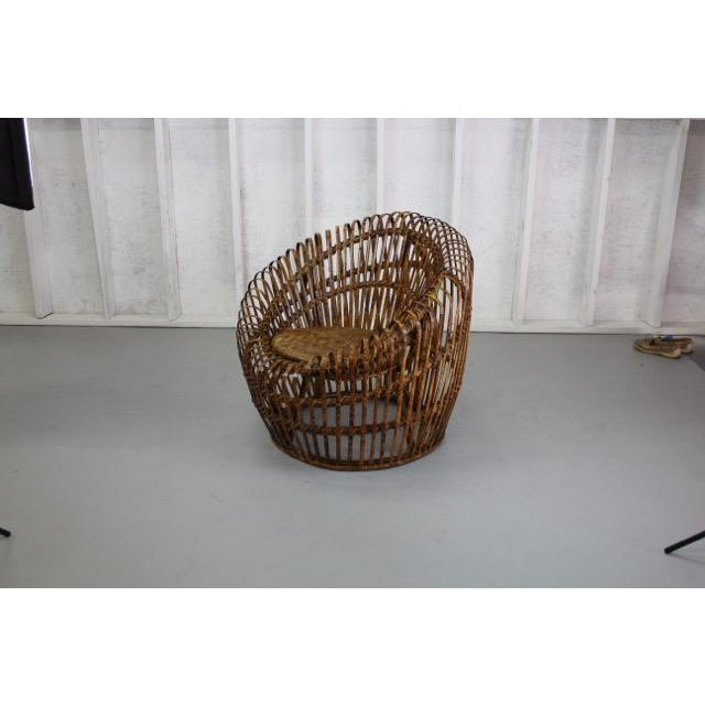 Unique basket shape in the style of mid-century designer Franco Albini. Split bamboo with tortoise shell finish. Woven...