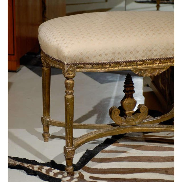 Late 19th Century French Louis XVI style gilded stool with a carved apron with swag and rosettes carved on each corner...