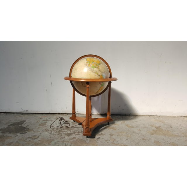 Beautiful vintage lighted Heirloom Globe by Replogle . Globe sits on mahogany cradle floor stand with wheels. In over all...